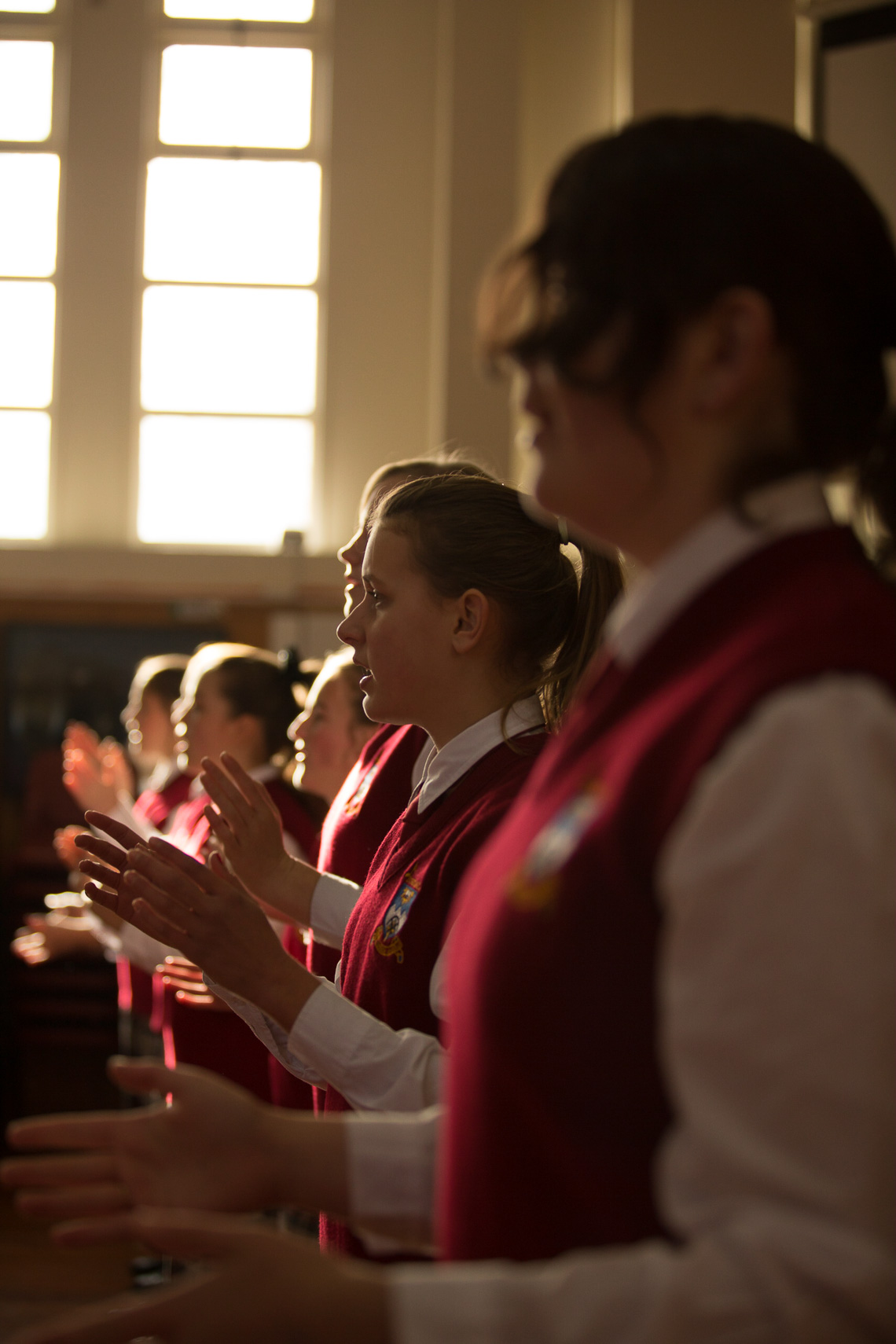 School students rehearsing in award winning choir by Paul Green Photographer