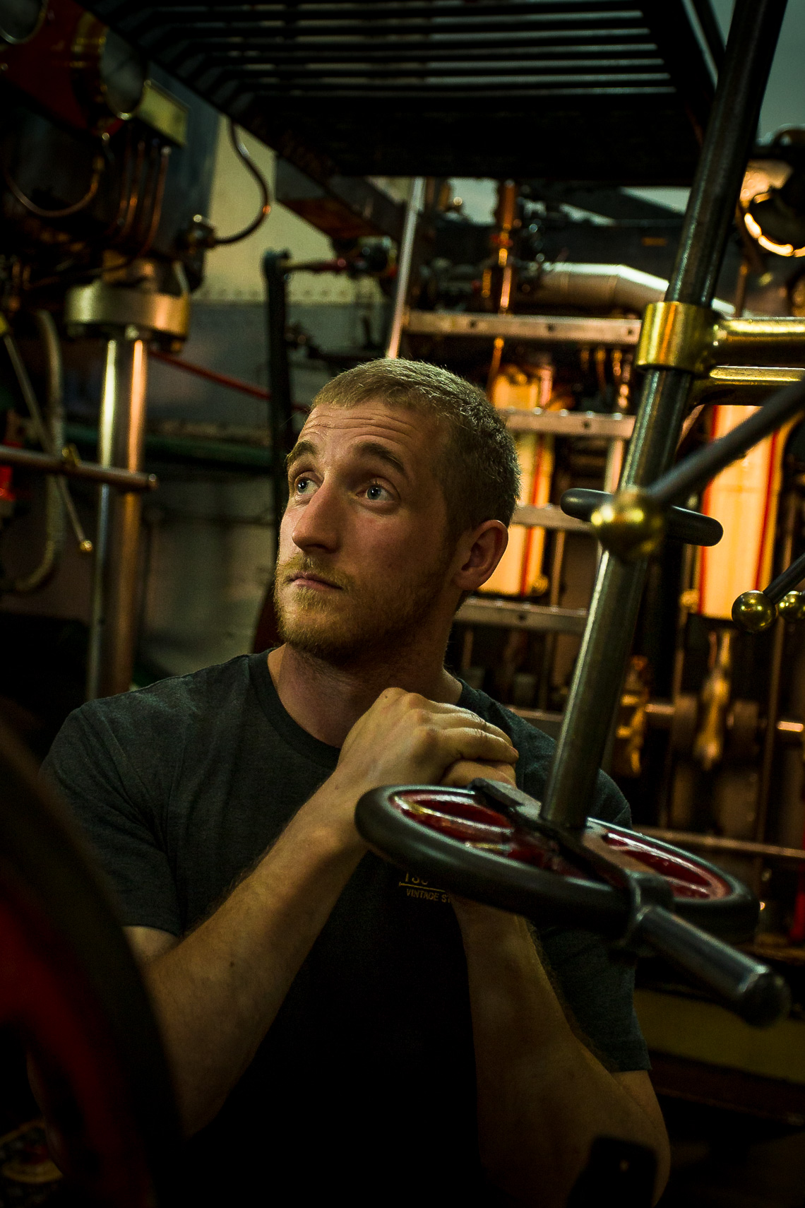 Engineer aboard steam ship takes a breather by Paul Green Photography