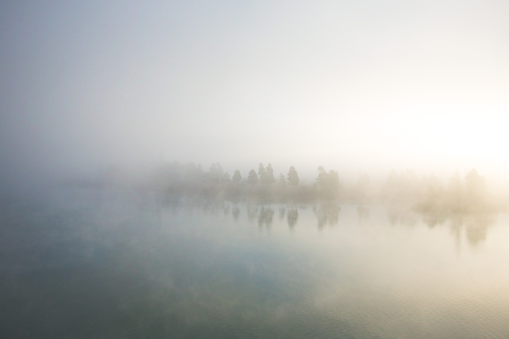 The backlit soft colours of mist on water by Paul Green Photographer
