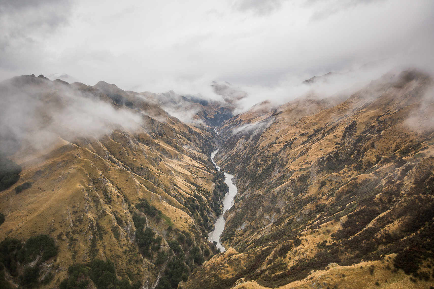 Clouds and rain in Skippers canyon from the air by Paul Green Photographer