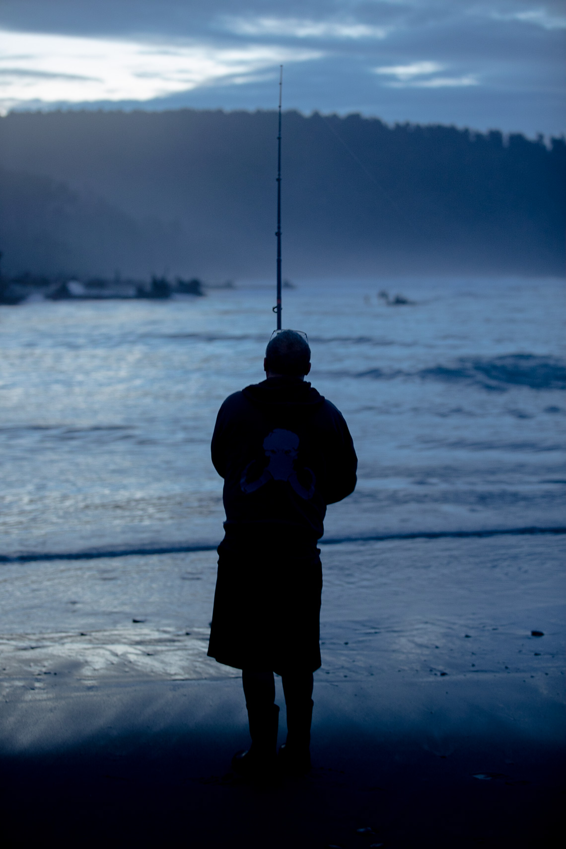 Fisherman trying his luck surfasting on the West Coast by Paul Green Photographer